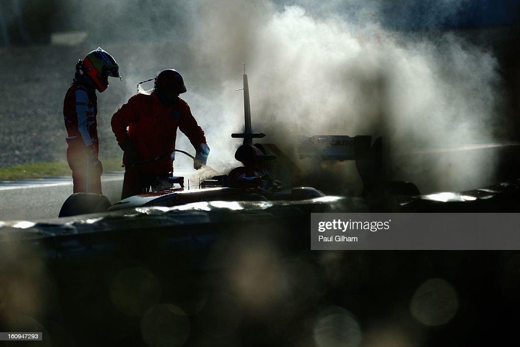 <a gi-track='captionPersonalityLinkClicked' href=/galleries/search?phrase=Pedro+de+la+Rosa&family=editorial&specificpeople=576029 ng-click='$event.stopPropagation()'>Pedro de la Rosa</a> of Spain and Ferrari examines his car following an engine failure during Formula One winter testing at Circuito de Jerez on February 8, 2013 in Jerez de la Frontera, Spain.
