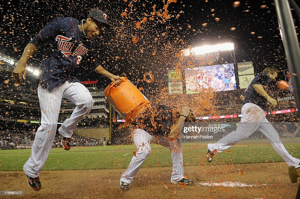 Pedro Florimon #25 and (R) <a gi-track='captionPersonalityLinkClicked' href=/galleries/search?phrase=Brian+Dozier&family=editorial&specificpeople=7553002 ng-click='$event.stopPropagation()'>Brian Dozier</a> #2 of the Minnesota Twins pour Gatorade on teammate <a gi-track='captionPersonalityLinkClicked' href=/galleries/search?phrase=Chris+Herrmann+-+Baseball+Player&family=editorial&specificpeople=7553012 ng-click='$event.stopPropagation()'>Chris Herrmann</a> #12 after a walk off win of the game against the Chicago White Sox on August 15, 2013 at Target Field in Minneapolis, Minnesota. The Twins defeated the White Sox 4-3.