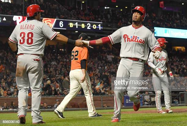 Pedro Florimon and Jorge Alfaro of the Philadelphia Phillies celebrate after they both scored on a bases loaded tworun rbi single from Freddy Galvis...