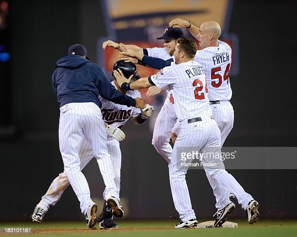 Pedro Florimon Josmil Pinto Chris Herrmann Trevor Plouffe and Eric Fryer of the Minnesota Twins celebrate a win of the game against the Detroit...
