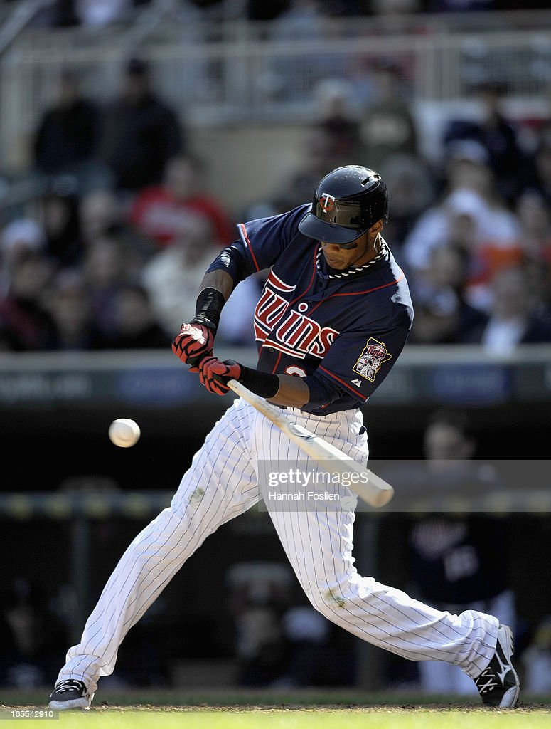Pedro Florimon #25 of the Minnesota Twins hits a two RBI double against the Detroit Tigers during the eighth inning of the game on April 4, 2013 at Target Field in Minneapolis, Minnesota. The Twins defeated the Tigers 8-2.