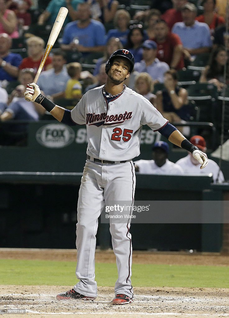 Pedro Florimon #25 of the Minnesota Twins reacts after striking out in the fifth inning of a baseball game against the Texas Rangers at Rangers Ballpark in Arlington on August 31, 2013 in Arlington, Texas.