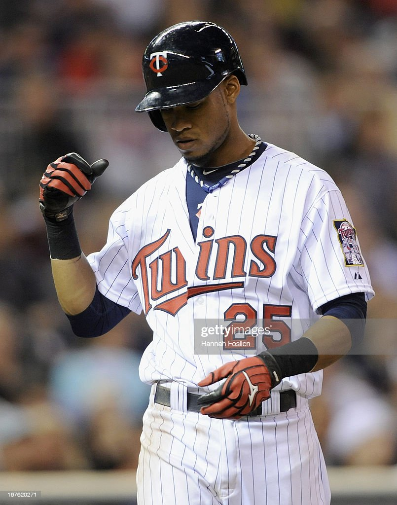 Pedro Florimon #25 of the Minnesota Twins reacts to striking out with a runner on third base during the fifth inning of the game against the Texas Rangers on April 26, 2013 at Target Field in Minneapolis, Minnesota.