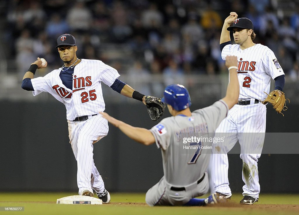Pedro Florimon #25 of the Minnesota Twins starts a double play by forcing out David Murphy #7 of the Texas Rangers at second base as <a gi-track='captionPersonalityLinkClicked' href=/galleries/search?phrase=Brian+Dozier&family=editorial&specificpeople=7553002 ng-click='$event.stopPropagation()'>Brian Dozier</a> #2 of the Minnesota Twins looks on during the fourth inning of the game on April 26, 2013 at Target Field in Minneapolis, Minnesota.