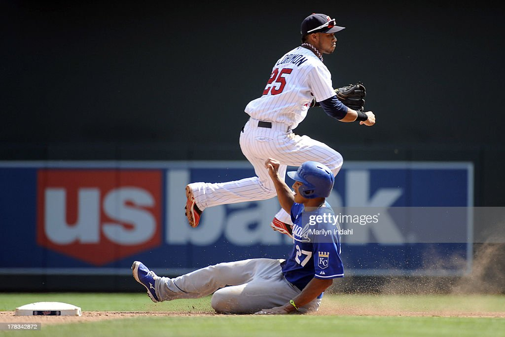Pedro Florimon #25 of the Minnesota Twins turns a double play in the sixth inning against Justin Maxwell #27 of the Kansas City Royals at Target Field on August 29, 2013 in Minneapolis, Minnesota.
