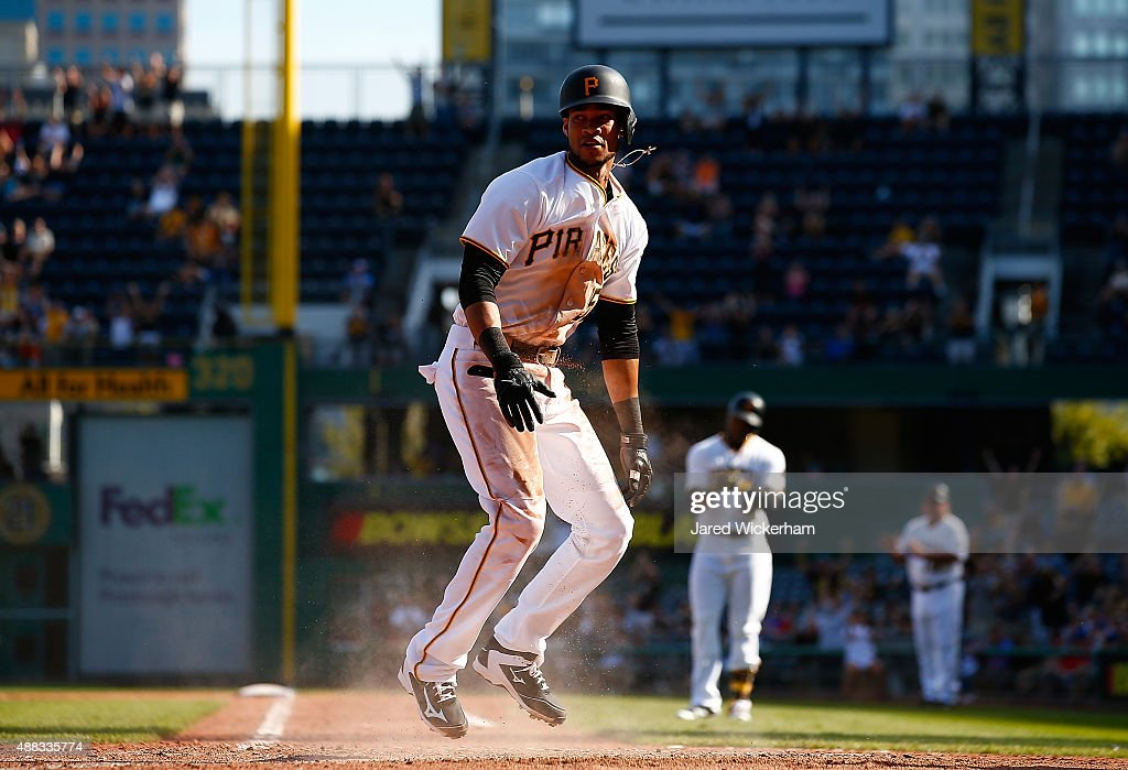 Pedro Florimon #51 of the Pittsburgh Pirates reacts after scoring the go-ahead run off of a sacrifice fly in the 8th inning against the Chicago Cubs during game one of the doubleheader at PNC Park on September 15, 2015 in Pittsburgh, Pennsylvania.