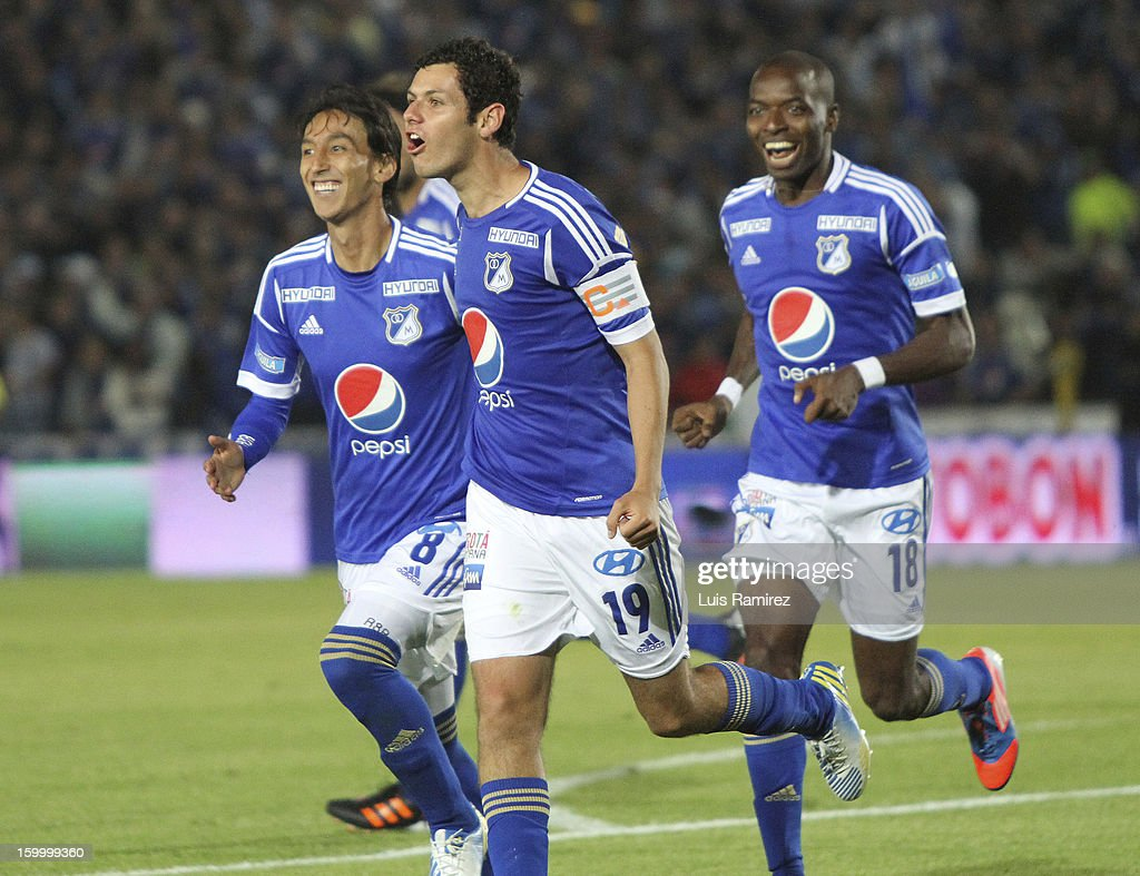 Pedro Franco (C) of Millonarios celebrates a scored goal against Independiente Santa Fe during a match between Millonarios and Independiente Santa Fe as part of the Superliga Postobon 2013 at the Nemesio Camacho Stadium on January 24, 2013 in Bogota, Colombia.