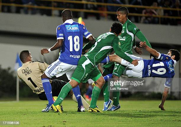 Pedro Franco of Millonarios fights for the ball with Farid Mondragon of Deportivo Cali during the match between Millonarios and Deportivo Cali as...