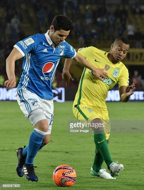 Pedro Franco of Millonarios fights for the ball with Macnelly Torres of Atletico Nacional during the Semi Finals first leg match between Millonarios...