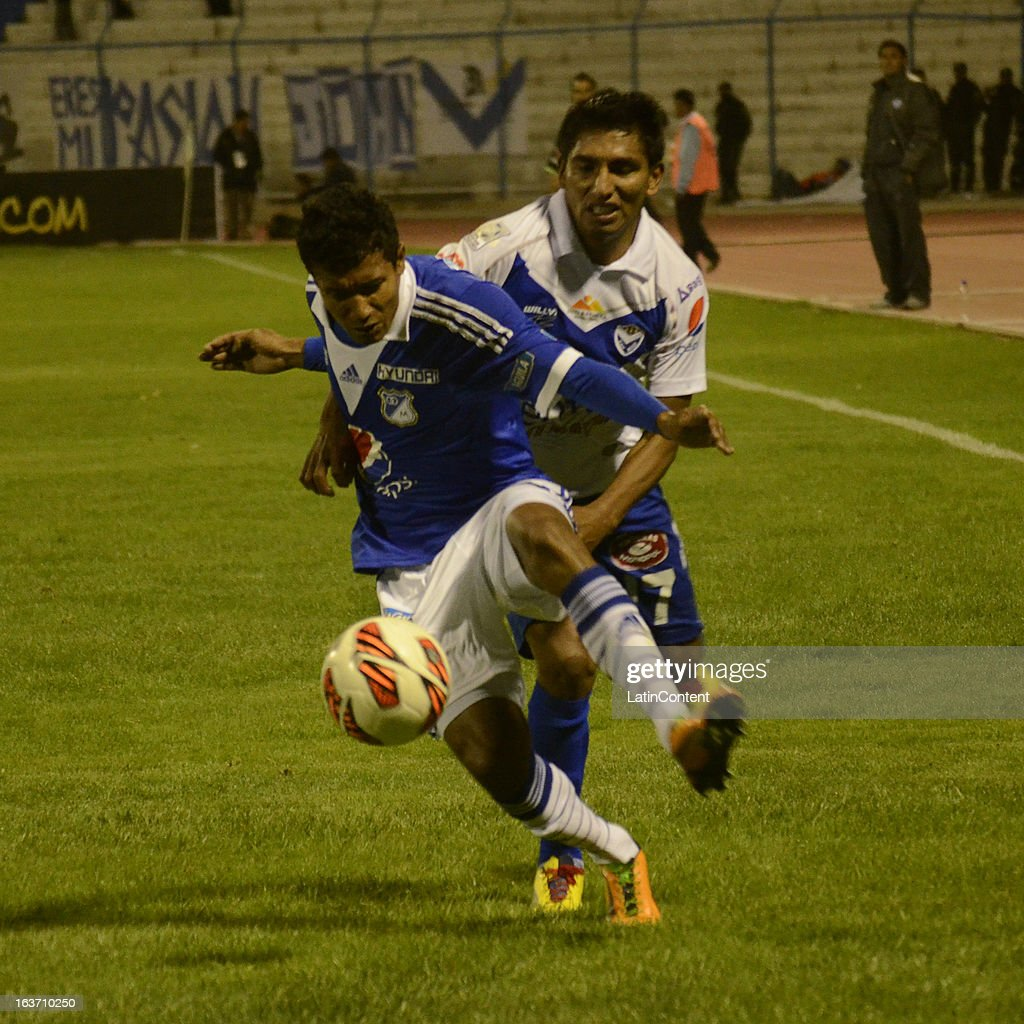 Pedro Franco of Millonarios struggles for the ball with Didi Torrico of San Jose during a match between Millonarios and San Jose as part of Copa Bridgestone Libertadores 2013 at Jesús Bermúdez Stadium on March 14, 2013 in San Jose de Oruro, Bolivia.