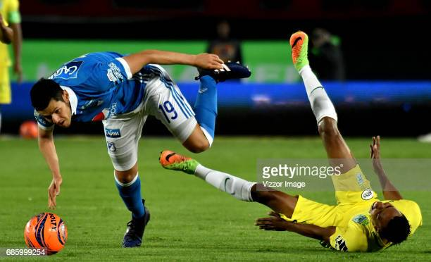 Pedro Franco of Millonarios vies for the ball with John Mosquera of Atletico Nacional during the match between Millonarios and Atletico Nacional as...