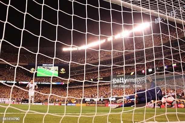 Pedro Gallese of Peru lets the shot of Dayro Moreno of Colombia slip under his body in the penalty shoot out during the Colombia Vs Peru Quarterfinal...