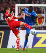 Pedro Geromel of Koeln and Demba Ba of Hoffenheim battle for the ball during the Bundesliga match between 1 FC Koeln and 1899 Hoffenheim at...