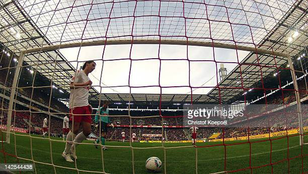 Pedro Geromel of Koeln picks the ball out of the net after the first goal of Bremen during the Bundesliga match between 1 FC Koeln and SV Werder...