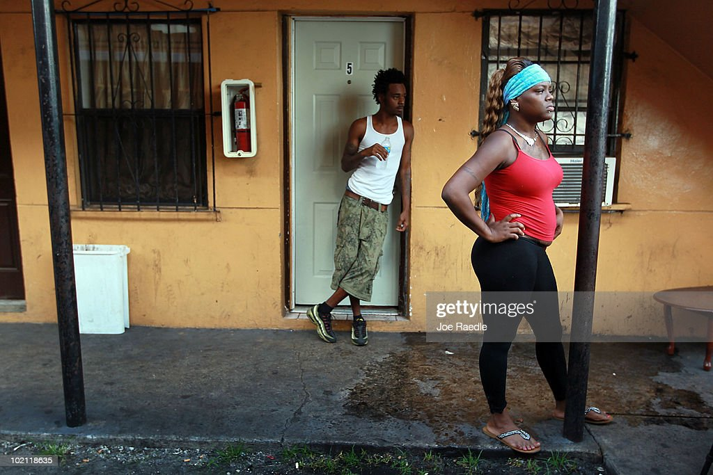Pedro Green (L) and Teshon Yarbough stand outside Green's apartment from which he fears being evicted on June 15, 2010 in Miami, Florida. A small protest organized by Take Back the Land tried to prevent the eviction but it was unsuccessful. According to the activists, the bank, which now owns the apartment complex, is forcing the current residents out and they have no other homes to move to.