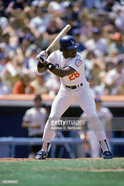 Pedro Guerrero of the Los Angeles Dodgers bats during an August 1984 game at Dodger Stadium in Los Angeles California