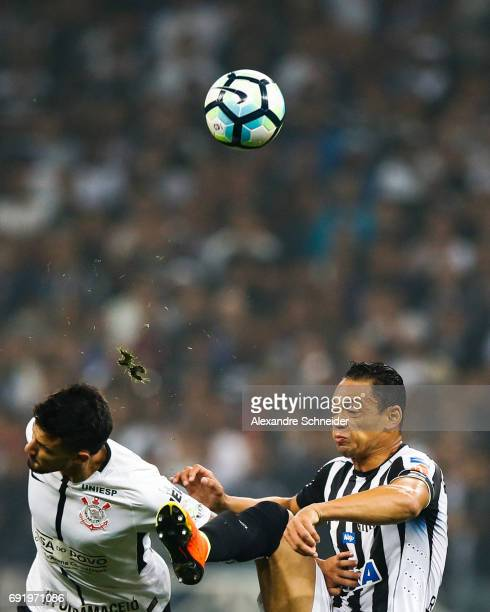 Pedro Henrique of Corinthians and Ricardo Oliveira of Santos in action during the match between Corinthians and Santos for the Brasileirao Series A...