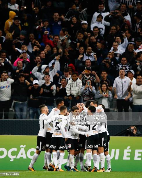 Pedro Henrique of Corinthians celebrates with his team mates their thirth oal during the match between Corinthians and Sport Recife for the...