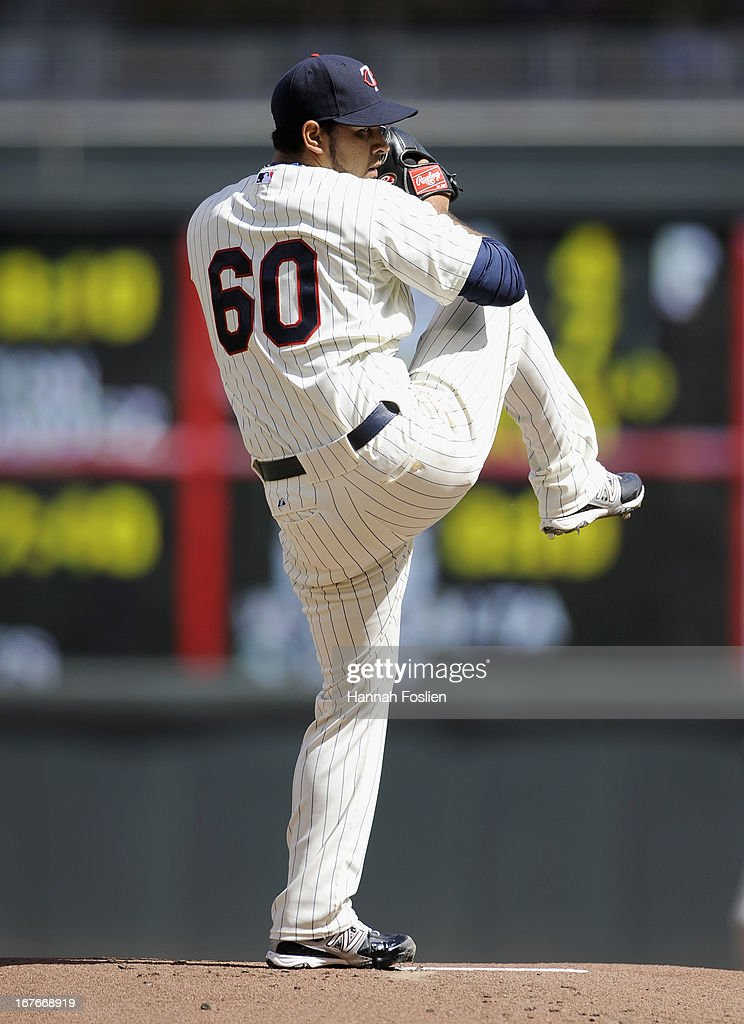 Pedro Hernandez #60 of the Minnesota Twins delivers a pitch against the Texas Rangers during the first inning of the game on April 27, 2013 at Target Field in Minneapolis, Minnesota.