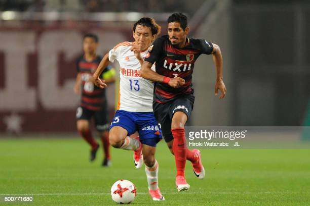 Pedro Junior of Kashima Antlers and Masaru Kato of Albirex Niigata compete for the ball during the JLeague J1 match between Kashima Antlers and...