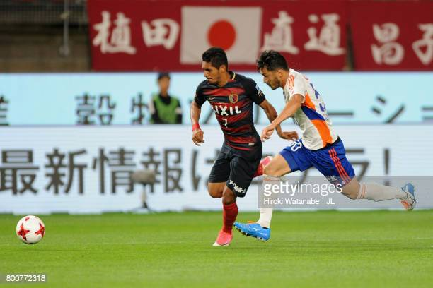 Pedro Junior of Kashima Antlers and Seitaro Tomisawa of Albirex Niigata compete for the ball during the JLeague J1 match between Kashima Antlers and...