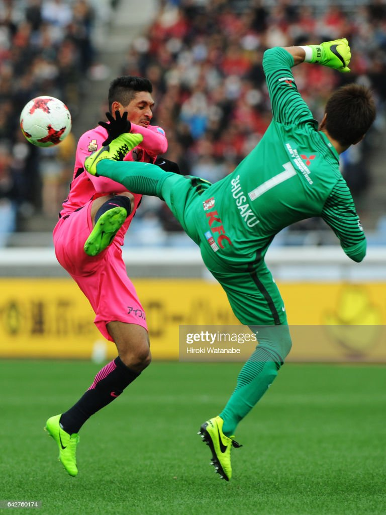 Pedro Junior #7 of Kashima Antlers and Shusaku Nishikawa #1 of Urawa Red Diamonds compete for the ball during the Xerox Super Cup match between Kashima Antlers and Urawa Red Diamonds at Nissan Stadium on February 18, 2017 in Yokohama, Kanagawa, Japan.