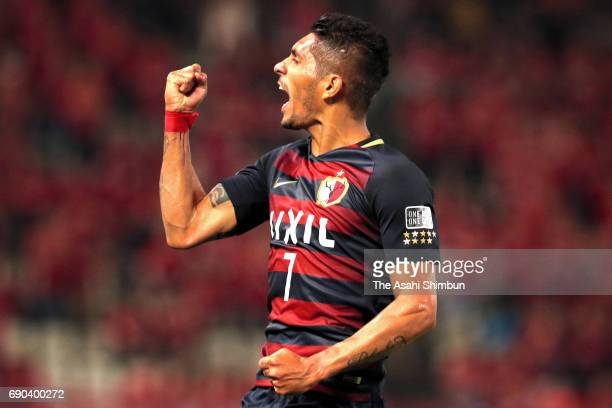 Pedro Junior of Kashima Antlers celebrates scoring his side's firt goal during the AFC Champions League Round of 16 match between Kashima Antlers and...