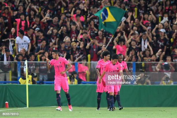 Pedro Junior of Kashima Antlers celebrates scoring his side's third goal with his team mates during the JLeague J1 match between Kashiwa Reysol and...