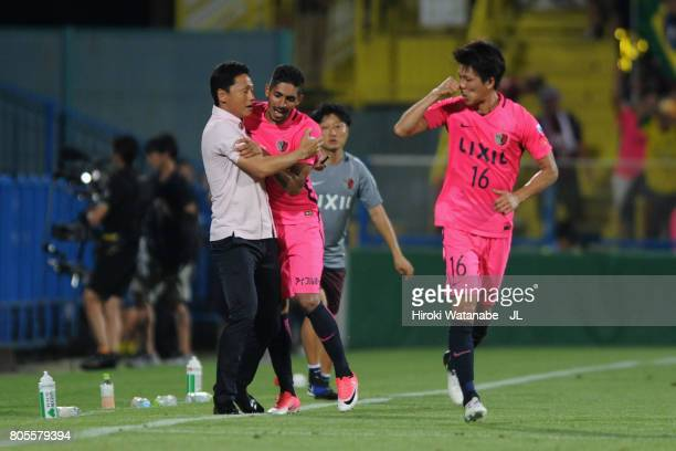 Pedro Junior of Kashima Antlers celebrates scoring his side's third goal with head coach Go Oiwa during the JLeague J1 match between Kashiwa Reysol...