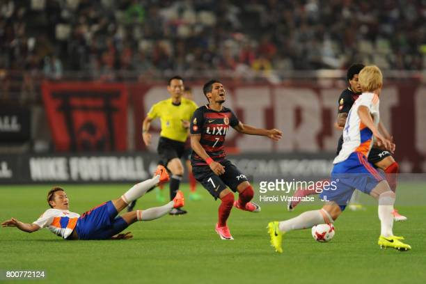 Pedro Junior of Kashima Antlers is challenged by Kei Koizumi of Albirex Niigata during the JLeague J1 match between Kashima Antlers and Albirex...