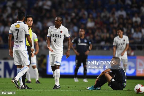 Pedro Junior of Kashima Antlers reacts after shown an yellow card by referee Hiroyuki Kimura during the JLeague J1 match between Gamba Osaka and...
