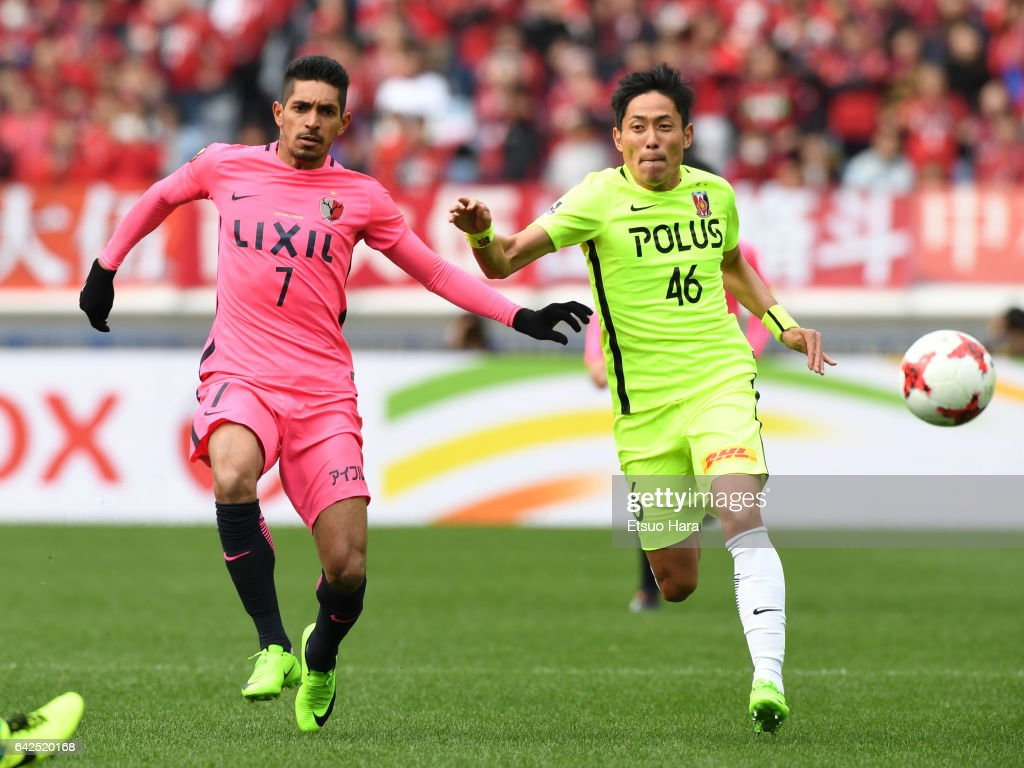 Pedro Junior#7 of Kashima Antlers and Ryota Moriwaki#46 of Urawa Red Diamonds compete for the ball during the Xerox Super Cup match between Kashima Antlers and Urawa Red Diamonds at Nissan Stadium on February 18, 2017 in Yokohama, Kanagawa, Japan.
