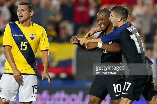 Pedro Larrea of Ecuador reacts as Nagbe Darlington of the United States celebrates with Christian Pulisic of the United States after scoring against...