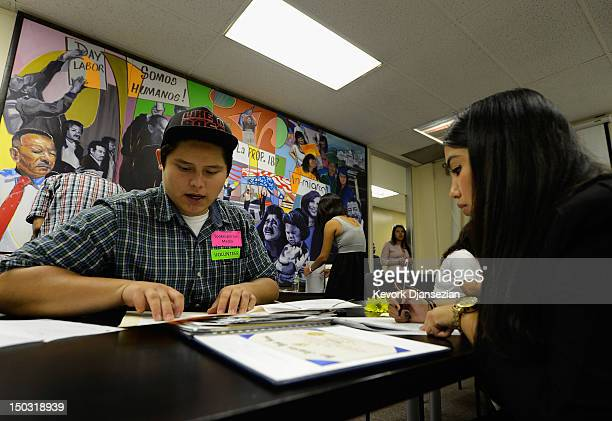Pedro Leon Martinez receives help from volunteer Maria Peralta in filing up his application for Deferred Action for Childhood Arrivals program at...