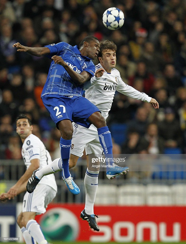 <a gi-track='captionPersonalityLinkClicked' href=/galleries/search?phrase=Pedro+Leon&family=editorial&specificpeople=4818187 ng-click='$event.stopPropagation()'>Pedro Leon</a> of Real Madrid jumps for a high ball with <a gi-track='captionPersonalityLinkClicked' href=/galleries/search?phrase=Alain+Traore&family=editorial&specificpeople=4146262 ng-click='$event.stopPropagation()'>Alain Traore</a> of AJ Auxerre during the Champions League group G match between Real Madrid and AJ Auxerre at Estadio Santiago Bernabeu on December 8, 2010 in Madrid, Spain.