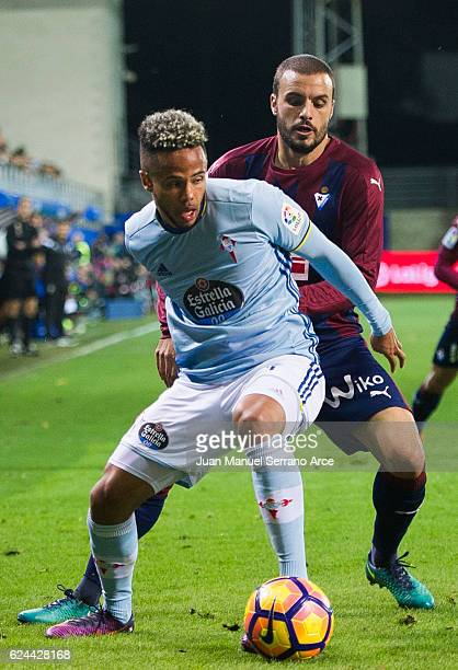 Pedro Leon of SD Eibar duels for the ball with Theo Bongonda of RC Celta de Vigo during the La Liga match between SD Eibar and RC Celta de Vigo at...