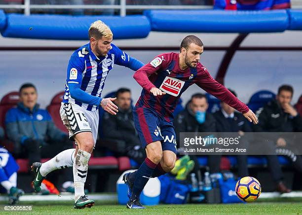Pedro Leon of SD Eibar duels for the ball with Theo Hernandez of Deportivo Alaves during the La Liga match between SD Eibar and Deportivo Alaves at...