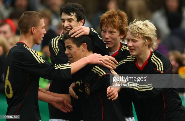 Pedro Manolo Rodas Steeg of Germany celebrates after scoring 20 with his teammates Felix Schroeter Levin Oeztunali Hendrik Brauer and Maximilian Hinz...