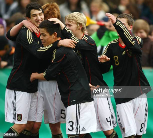 Pedro Manolo Rodas Steeg of Germany celebrates after scoring his team's second goal with his team mates Levin Oeztunali Hendrik Brauer Maximilian...