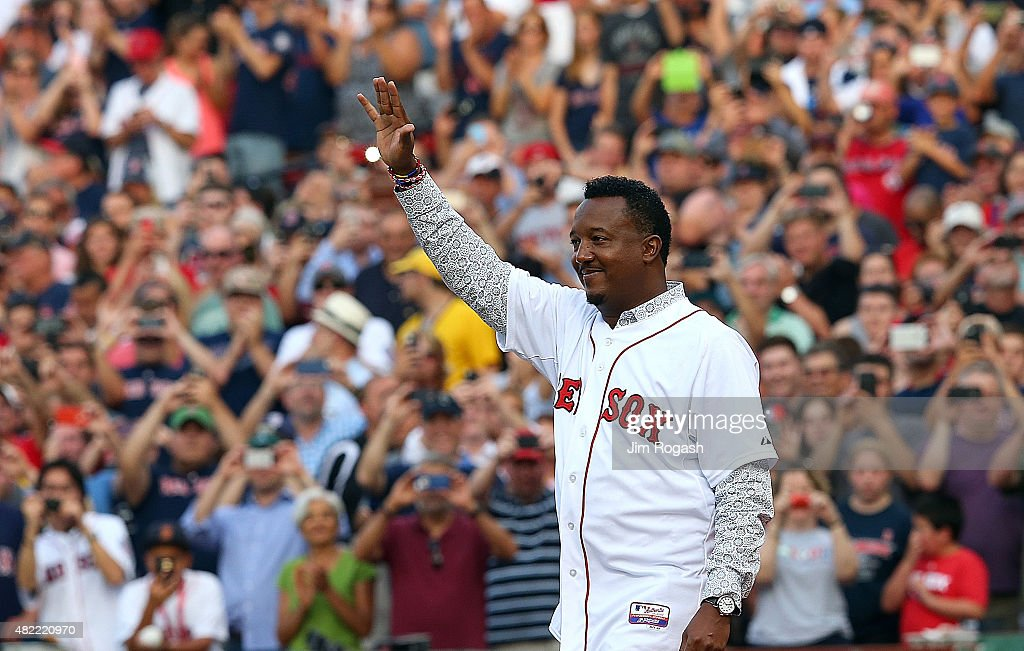 <a gi-track='captionPersonalityLinkClicked' href=/galleries/search?phrase=Pedro+Martinez&family=editorial&specificpeople=171773 ng-click='$event.stopPropagation()'>Pedro Martinez</a>, a former member of the Boston Red Sox, waves as he is being introduced during a ceremony to retire Martinez's number 45, before a game with the Chicago White Sox at Fenway Park on July 28, 2015 in Boston, Massachusetts.
