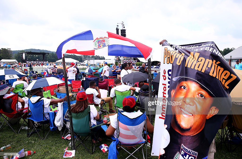 Pedro Martinez fans camp near the Induction Ceremony stage at the National Baseball Hall of Fame on July 26 2015 in Cooperstown New YorkMartinez...