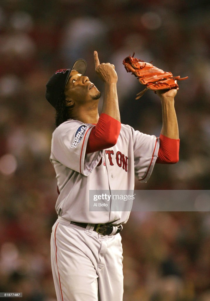 Pedro Martinez of the Boston Red Sox points the sky after being taken out of game three of the World Series against the St Louis Cardinals on October...