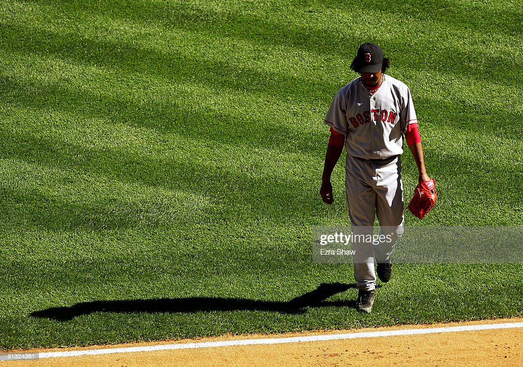Pedro Martinez #45 of the Boston Red Sox walks off the field after being taken out of the sixth inning against the New York Yankees on September 19, 2004 at Yankee Stadium in the Bronx, New York. The Yankees beat the Red Sox 11-1.
