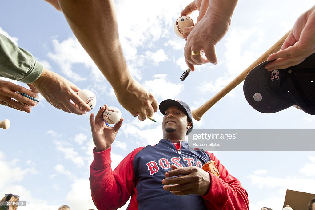 Pedro Martinez, special assistant to the general manager of the Boston Red Sox, signs his autograph for fans during spring training at JetBlue Park on Tuesday, Feb. 19, 2013.