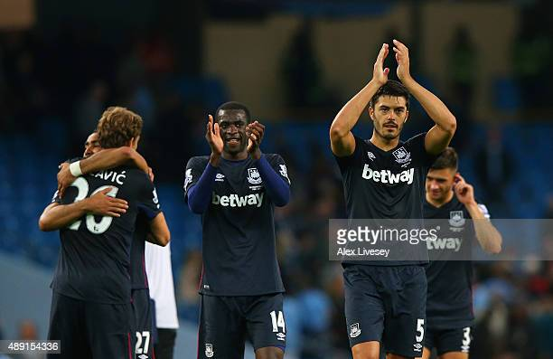 Pedro Mba Obiang and James Tomkins of West Ham United applaud the fans during the Barclays Premier League match between Manchester City and West Ham...