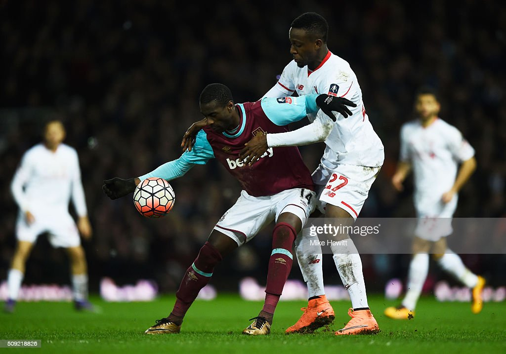 Pedro Mba Obiang of West Ham United holds off <a gi-track='captionPersonalityLinkClicked' href=/galleries/search?phrase=Divock+Origi&family=editorial&specificpeople=10183754 ng-click='$event.stopPropagation()'>Divock Origi</a> of Liverpool during the Emirates FA Cup Fourth Round Replay match between West Ham United and Liverpool at Boleyn Ground on February 9, 2016 in London, England.