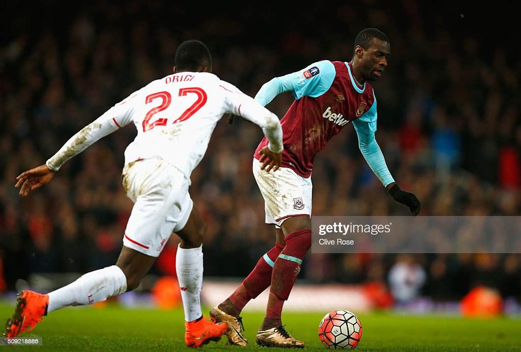 Pedro Mba Obiang of West Ham United is chased by <a gi-track='captionPersonalityLinkClicked' href=/galleries/search?phrase=Divock+Origi&family=editorial&specificpeople=10183754 ng-click='$event.stopPropagation()'>Divock Origi</a> of Liverpool during the Emirates FA Cup Fourth Round Replay match between West Ham United and Liverpool at Boleyn Ground on February 9, 2016 in London, England.