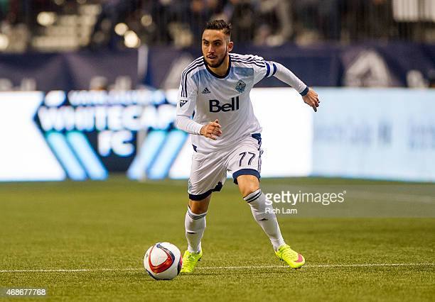 Pedro Morales of the Vancouver Whitecaps FC runs with the ball in MLS action against the Portland Timbers on March 28 2015 at BC Place Stadium in...