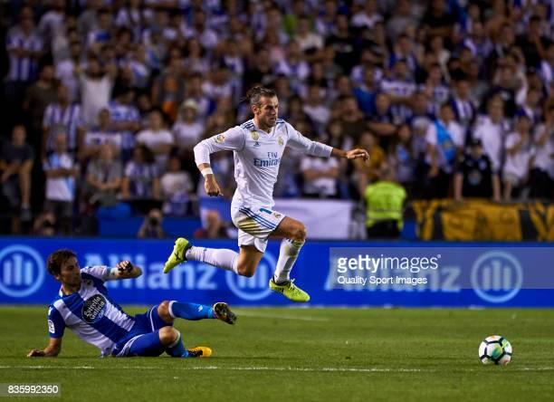 Pedro Mosquera of Deportivo de La Coruna competes for the ball with Gareth Bale of Real Madrid during the La Liga match between Deportivo La Coruna...