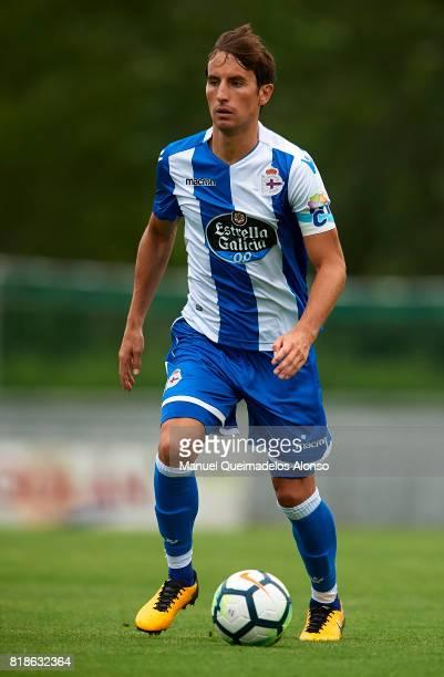 Pedro Mosquera of Deportivo de La Coruna runs with the ball during the preseason friendly match between Cerceda and Deportivo de La Coruna at O Roxo...